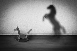 rocking horse with upright horse shadow