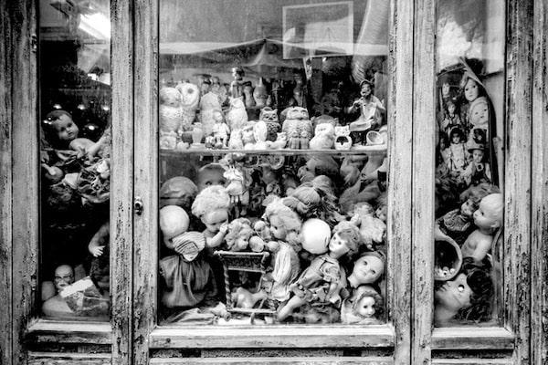 Ivan dollheads crammed into window