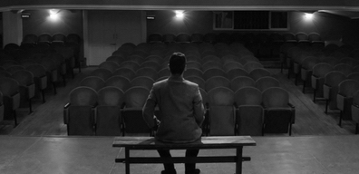 man in empty theatre