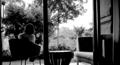 woman on the patio watching trees