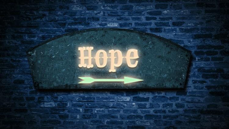 the word hope with an arrow pointing forward