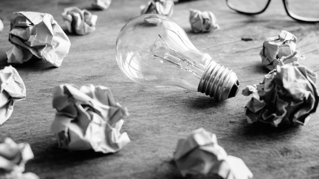 Creativity concept - wrinkled papers and a light bulb