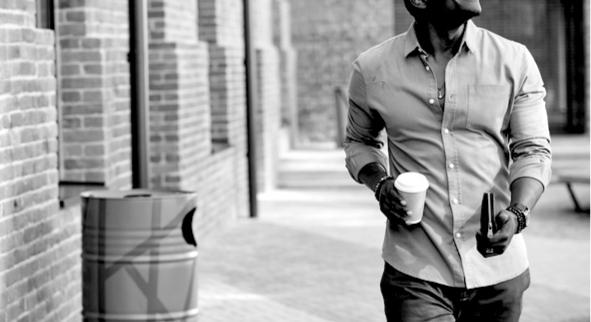 Man walking on the street happy