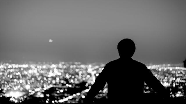 Man watching the city lights at night