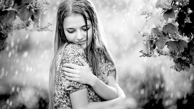 Female happy giving herself a hug