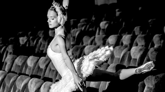 Ballerina dancing alone in the spectators area